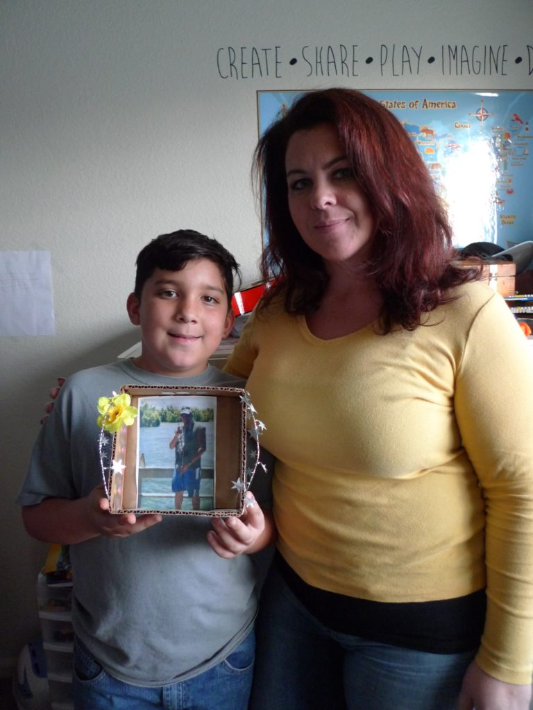 Anne Norris puts her arm around her 9-year-old son, Andrew, who is holding a photo of his dad, José Ricardo Garay-Garay. Garay-Garay went missing in 2009, when he tried to cross the U.S.-Mexico border on foot.