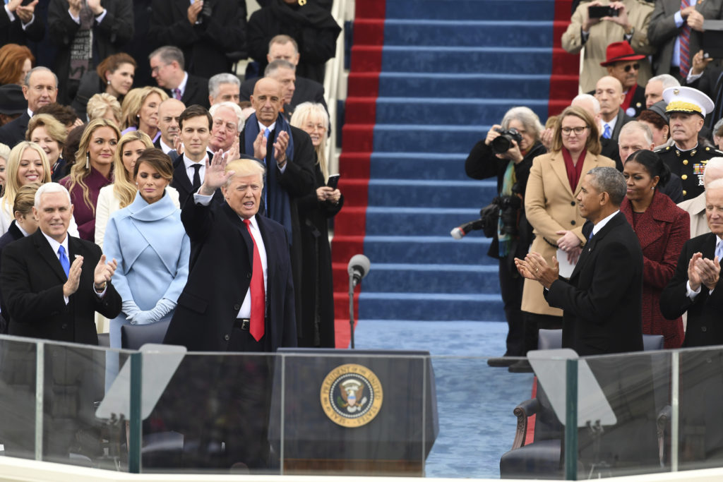 Thomas Barrack, wearing blue a scarf, stood just behind the Trump family at the inauguration of Donald Trump in January.