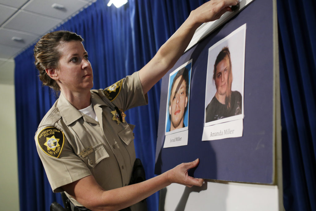 "Las Vegas police Officer Laura Meltzer displays photos of Patriot movement extremists Jerad and Amanda Miller before a news conference June 9, 2014. The day before, the couple gunned down two police officers in a pizzeria, leaving a swastika and ""Don't tread on me"" flag on one victim, before killing a civilian who attempted to intervene."
