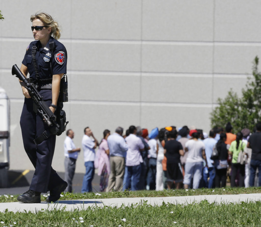 Police patrol the scene of a shooting inside a Sikh temple in Oak Creek, Wis., in August 2012. Wade Michael Page, a member of the neo-Nazi group Hammerskin Nation, killed six worshippers during a rampage before killing himself.