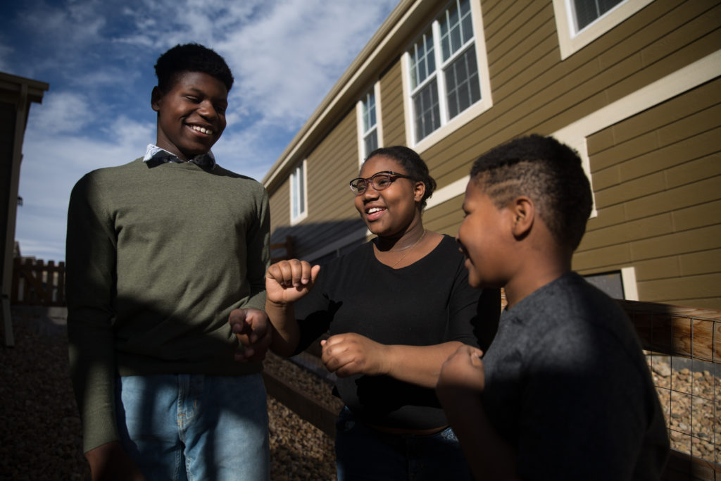 5689658f Chris (from left), 12; Aaliyah, 13; and Khalil Stevens-Roesener, 10, say  they've always been among only a handful of black kids at school in Arvada,  Colo.