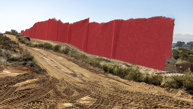 a border wall built out of red tape cuts through the desert
