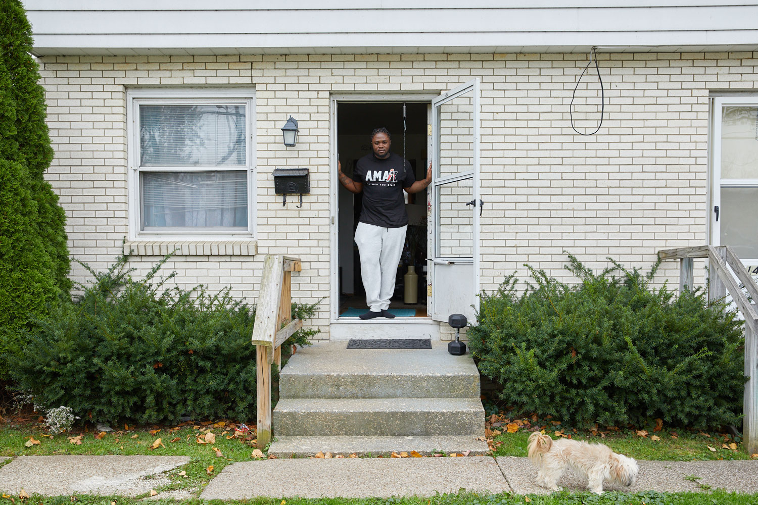 Melquan Barnett stands in the doorway of a house.
