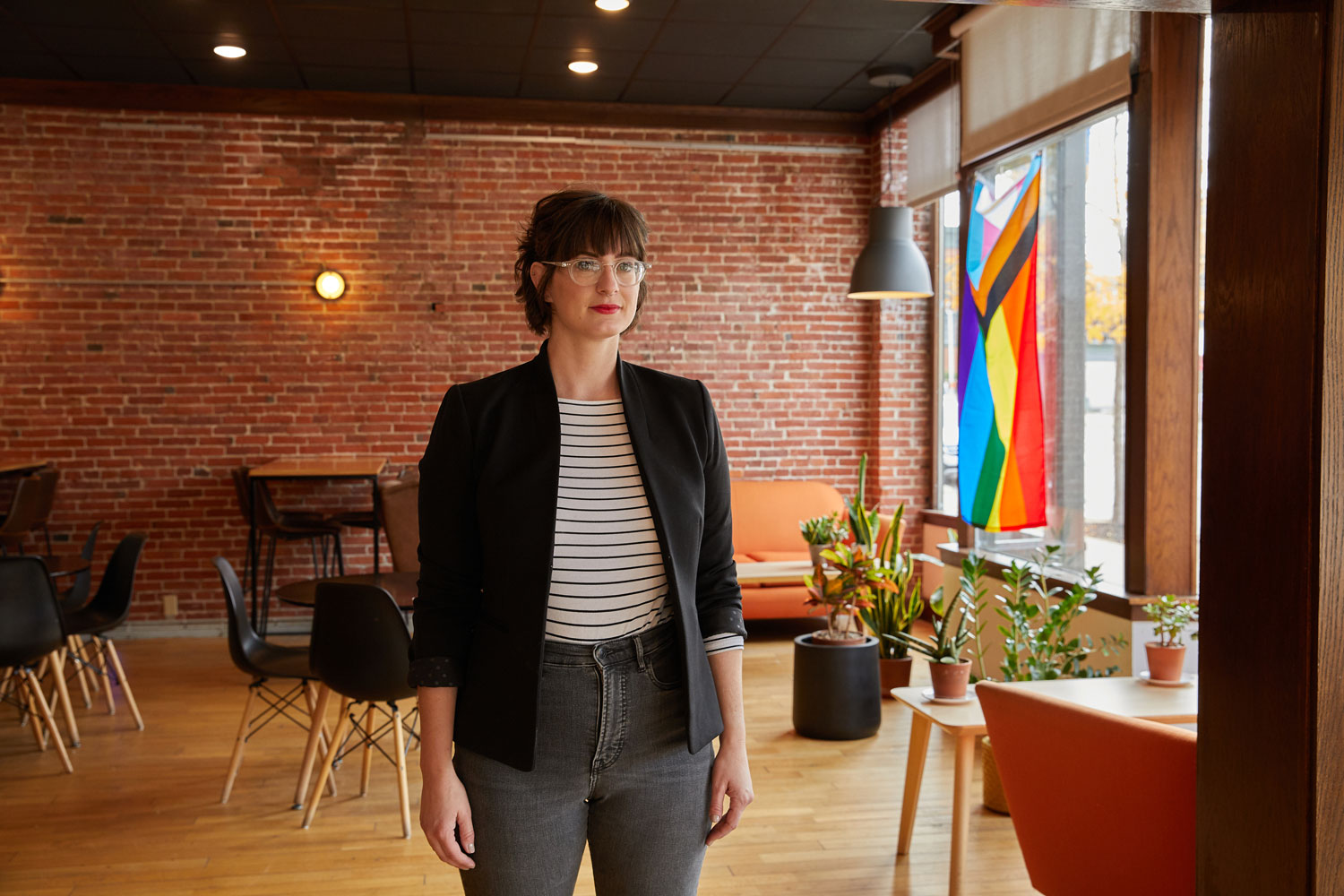 Hannah Kirby stands inside her coffee shop.