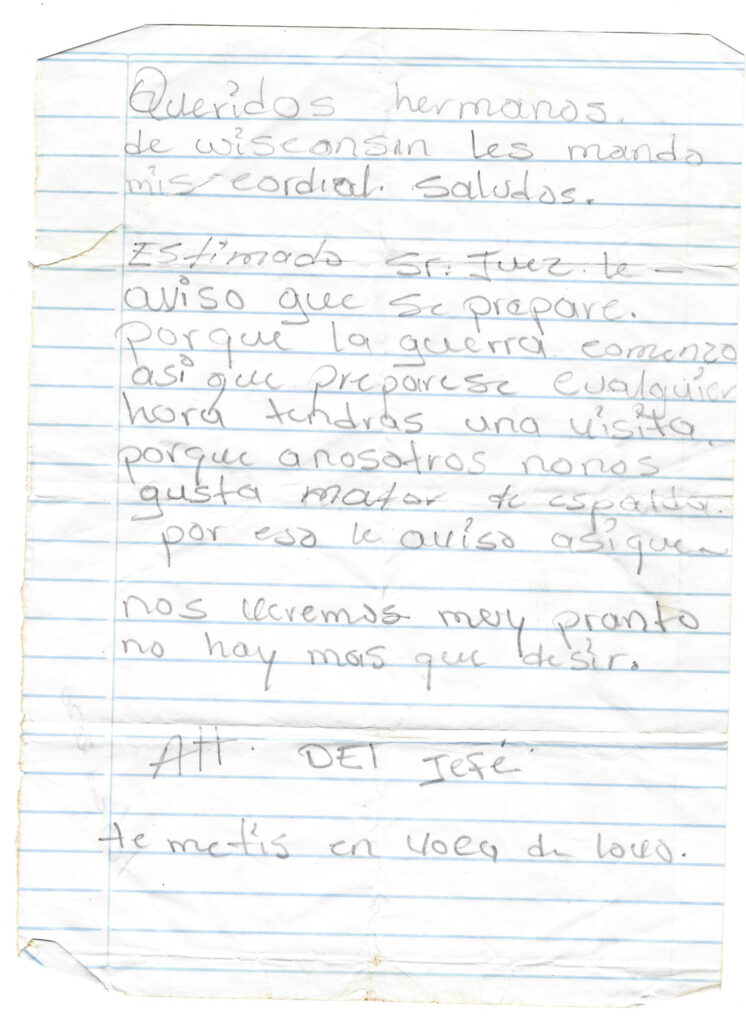 A handwritten note threatens violence against the residents of Wisconsin, Nicaragua.